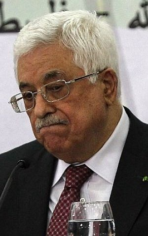 Palestinian Authority President Mahmoud Abbas gestures as he gives a speech during a meeting with the Palestine Liberation Organization's Central Council in the West Bank city of Ramallah, on April 26, 2014. (photo credit: AFP/Abbas Momani)