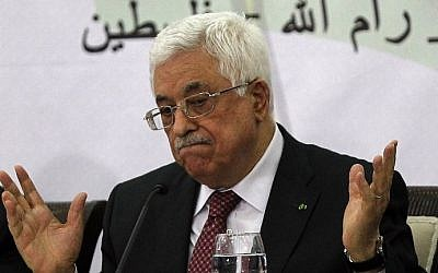 File: Palestinian Authority President Mahmoud Abbas gestures during a meeting with the Palestine Liberation Organization's Central Council in the West Bank city of Ramallah, on April 26, 2014. (AFP/Abbas Momani)