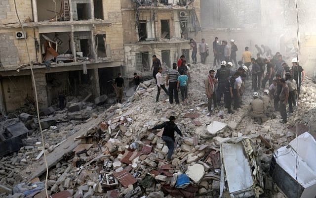 "People inspect the rubble after a building collapsed following a reported bombardment with explosive-packed ""barrel bombs"" by Syrian government forces in the al-Mowasalat neighborhood of the northern Syrian city of Aleppo, on April 27, 2014. (AFP Photo/Aleppo Media Centre/Zein al Rifai)"