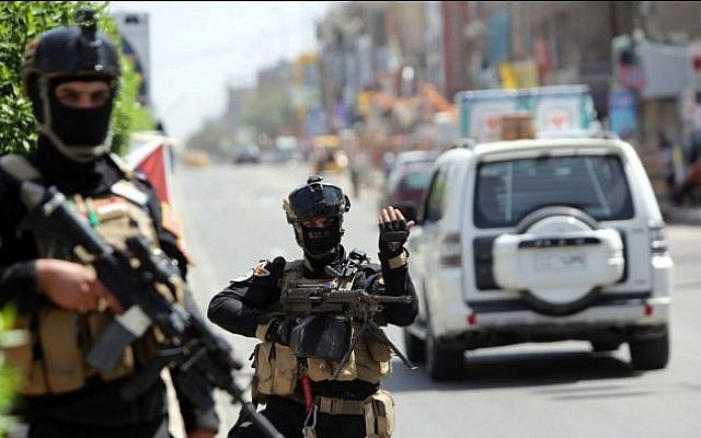 Illustrative photo of members of Iraq's anti-terrorism force standing guard in the capital Baghdad on April 29, 2014. (AFP/Ahmad al-Rubaye)
