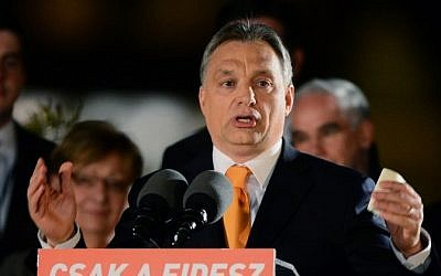 Hungarian Prime Minister Viktor Orban delivers a speech after winning the parliamentary election with members of his FIDESZ party on April 6, 2014 in Budapest . (photo credit: AFP/ATTILA KISBENEDEK)
