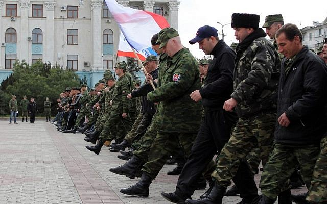 Russian soldiers and pro-Russian volunteers during a military parade rehearsal in preparation for the Victory Day parade in Simferopol, Crimea, on April 12, 2014. (photo credit: AFP/Yuri Lashov)