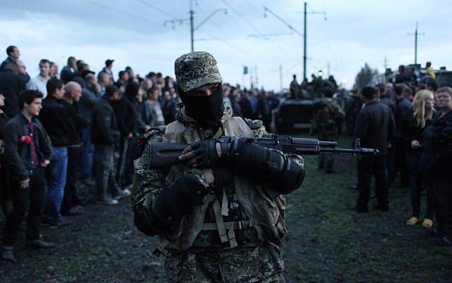 After gun battle, east Ukraine separatists declare curfew