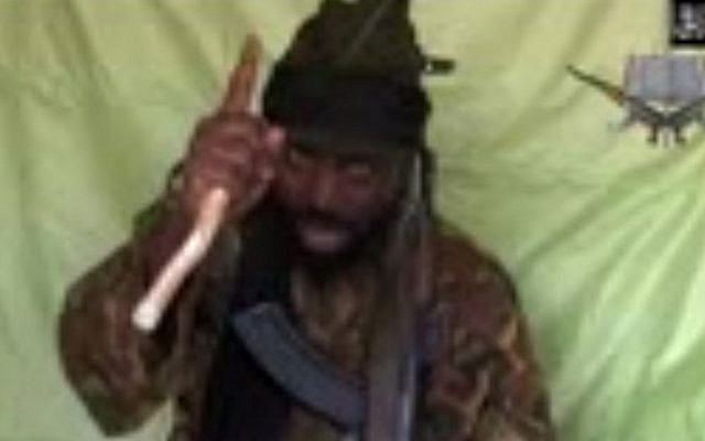 A video obtained by AFP shows a man claiming to be the leader of Nigerian Islamist extremist group Boko Haram Abubakar Shekau (Photo credit: AFP/Boko Haram)
