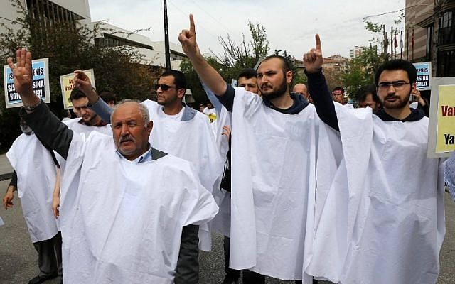 Supporters of the Egyptian Muslim Brotherhood stage a rally to protest against the death penalties for the members of the radical group in Egypt, in Ankara on April 25, 2014. (photo credit: AFP/ADEM ALTAN)