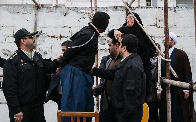 Balal Abdullah, who killed Iranian youth Abdolah Hosseinzadeh in a street fight with a knife in 2007, is rescued from the gallows by the mother of his victim during his execution ceremony in the northern city of Nowshahr on April 15, 2014 (photo credit: AFP/Arash Khamooshi/ISNA)