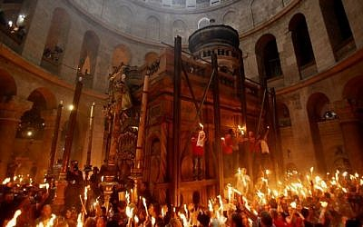 Christian worshippers gather in the Church of the Holy Sepulcher in Jerusalem's Old City on April 19, 2014 (Gali Tibbon/AFP)