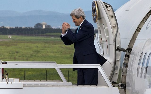 US Secretary of State John Kerry gestures while leaving Algeria en route to Rabat, Morocco on April 3, 2014.(photo credit: AFP/POOL/Jacquelyn Martin)