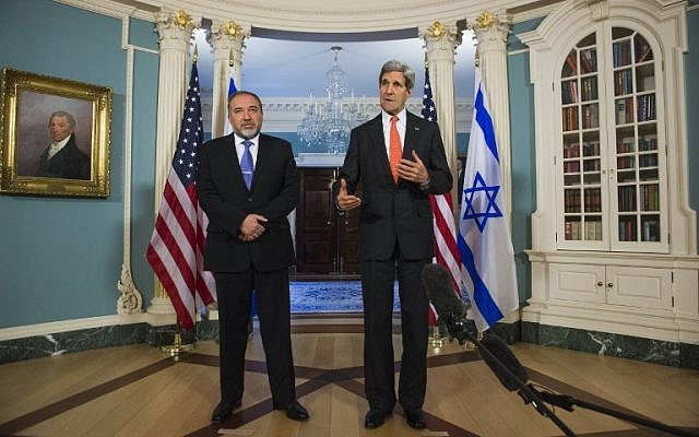 Foreign Minister Avigdor Liberman, left, with US Secretary of State John Kerry at the State Department in Washington, DC (photo credit: AFP/Saul Loeb)