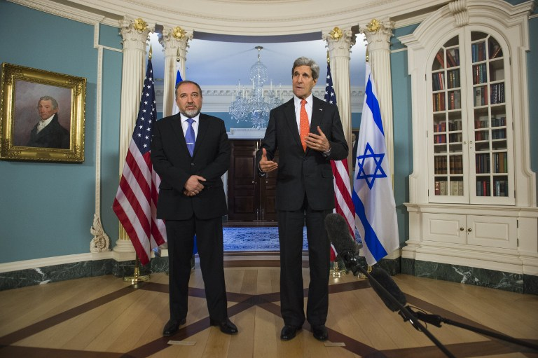 Foreign Minister Avigdor Liberman, left, with US Secretary of State John Kerry at the State Department in Washington, DC, on Wednesday (photo credit: AFP/Saul Loeb)