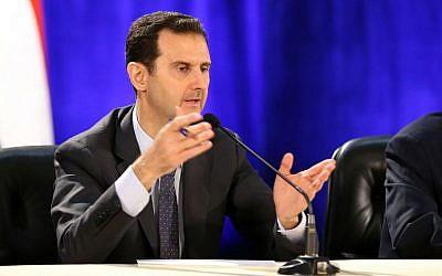 Syrian President Bashar al-Assad addressing an audience, April 13, 2013. (photo credit: AFP/HO/SANA)