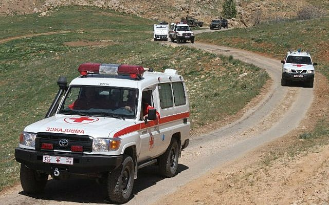 Led by vehicles of the Lebanese Red Cross, an aid convoy heads towards the village of Tufeil, close to Lebanon's eastern border with neighboring Syria, on April 22, 2014,  (photo credit: AFP/STR)