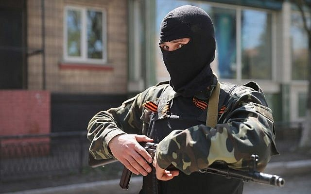 A pro-Russian militant stands guard in front of the occupied Ukraine Security Service building on April 21, 2014 in Slovyansk, Ukraine. (photo credit: Scott Olson/Getty Images/AFP)