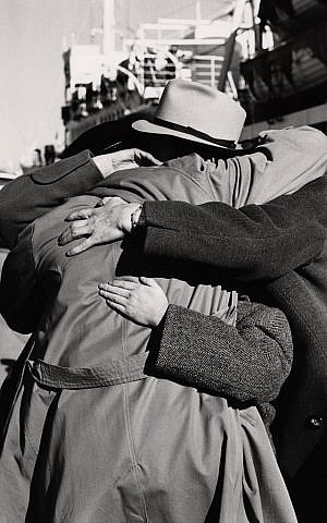 Ruth Gruber. Romanian families reunite in Haifa Port. Many had not seen each other since the beginning of World War II, Israel, 1951. (© Ruth Gruber)