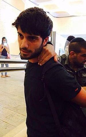 A student is arrested at the Hebrew University of Jerusalem for rallying against the Christian Arab draft (photo credit: Hala Marsood)