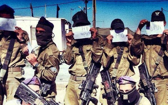 "Soldiers hold signs supporting ""David from the Nahal Brigade"" (photo credit: Facebook)"
