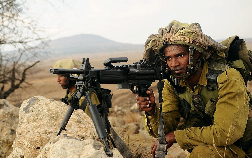 A soldier of Ethiopian heritage in a Nahal Brigade drill in the Golan Heights (photo credit: Nir Gal/IDF Spokesperson's Unit)