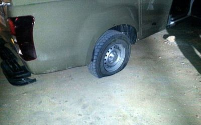 The slashed tire of an IDF vehicle in Yitzhar in the West Bank, Monday, April 7, 2014 (photo credit: Tazpit News Agency)