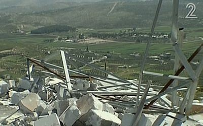 An IDF outpost destroyed by settlers in the West Bank settlement of Yitzhar, April 2014. (screen capture: Channel 2)
