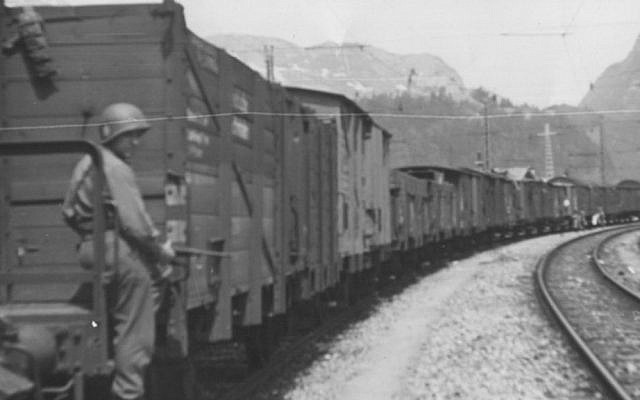 American soldier guards the Hungarian Gold Train in Werfen [Salzburg], Austria, May 1945. (Courtesy National Archives, photo no. 239-PA-1-1-9)