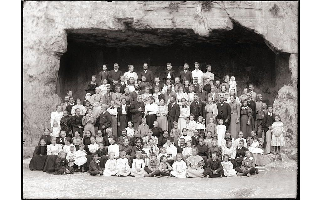 The extended community of the American Colony posing in the Tombs of the Kings in Jerusalem. The community continued to pose for group photographs, a valuable chronological source for descendants and researchers, documenting the transformative eras of their eccentric communal and personal lives. (photo credit: Courtesy American Colony Archive Collections, reproduction from dry plate glass)