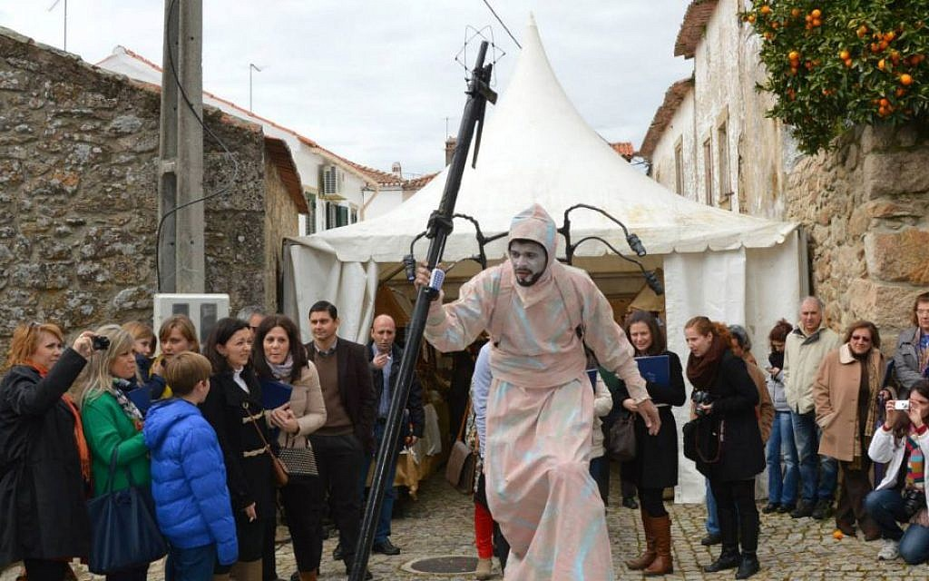 An actor entertaining visitors to the Jewish Christian Passover Celebration last month at Medelim, Portugal. (Beira Baixa TV via JTA)