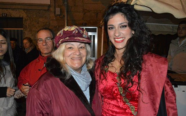 The Israeli Ladino performer Mor Karbasi right with Maria Tavares, a native of Medelim in Portugal, at the town's Jewish and Christian Passover celebration last month. (Beira Baixa TV via JTA)