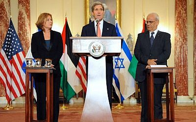 US Secretary of State John Kerry stands with Justice Minister Tzipi Livni, Israel's chief negotiator (left), and Palestinian chief negotiator Saeb Erekat, after the resumption of Israeli-Palestinian peace talks, July 30, 2013, at the State Department in Washington. (photo credit: US State Department)