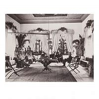 Swedish Colony members lounging in the salon [Pasha Room] in spring 1897, with its original hand-painted wooden ceiling, considered one of the oldest in the Middle East. (photo credit: American Colony Photo Department photographers/from members and activities of the American Colony, American Colony Archive Collections)