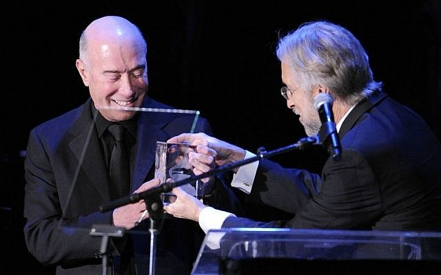 David Geffen, left, accepts the President's Merit Award from the President of the National Academy of Recording Arts and Sciences, on Feb. 12, 2011 in Beverly Hills, Calif. (photo credit: AP/Mark J. Terrill)