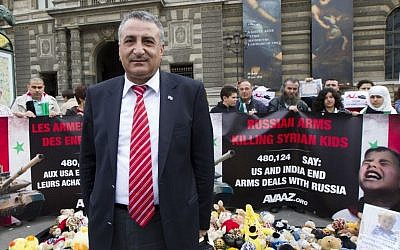 Syrian oppositionist Kamal Al-Labwani at an anti-Assad demonstration in Paris, June 12, 2012 (photo credit: AP/Jacques Brinon)