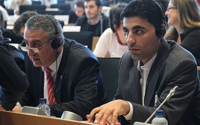 Kamal Al-Labwani (left), attends a meeting at the European Parliament in Brussels, June 2012 (photo credit: AP/Yves Logghe)