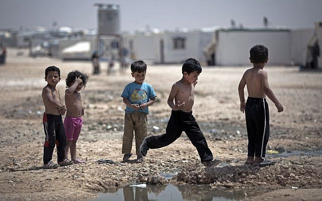 File: Syrian children play under the heat of the midday sun in the Zaatari refugee camp in Jordan, near the Syrian border, on April 17, 2014. (AP/Khalil Hamra)