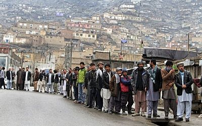 Afghan men line up outside a polling station to cast their ballots, in Kabul, Afghanistan, on Saturday, April 5, 2014.  (photo credit: AP Photo/Rahmatullah Nikzad)