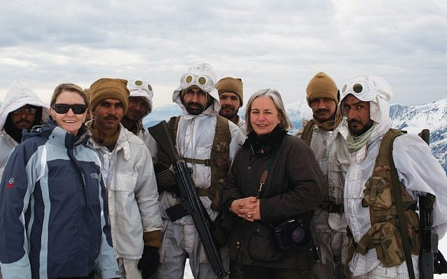 In this February 2012 photo, Kathy Gannon, front left, AP special correspondent for Afghanistan and Pakistan, and veteran AP photographer Anja Niedringhaus, third right, pose with Pakistani soldiers in the remote border area opposite Afghanistan's northeastern Kunar province.  (photo credit: AP)