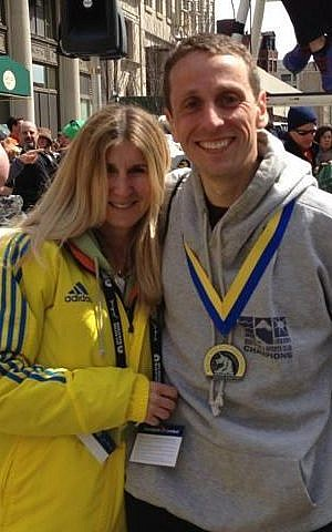 Just minutes before the bombs exploded at last year's Boston Marathon, Rachel Glazer and Andrew Becker of Boston posted for this photo. On Monday, Glazer and Becker will return to the Marathon as a volunteer finish line announcer and runner, respectively (photo courtesy: Rachel Glazer)
