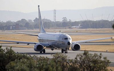 A US Navy plane, P-8 Poseidon, taxies to the end of the runway for takes off from Perth Airport on route to conduct search operations for missing Malaysia Airlines Flight 370 in southern Indian Ocean, near the coast of Western Australia, Saturday, April 5, 2014. (file photo credit: Rob Griffith/AP)