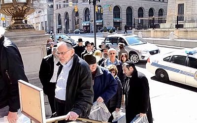 Members of the Baltimore Jewish community arrive to protest at a hearing for the retrial of Wayne Stephen Young who was convicted in 1972 of the murder of Esther Lebowitz, March 20, 2014. (screen capture:YouTube/jeffcohn)