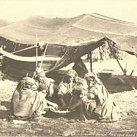Bedouin women eating (undated) (photo credit: © DEIAHL, Jerusalem)