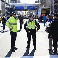 Illustrative: Police stand by near the finish line of the 118th Boston Marathon in Boston, Massachusetts, April 20, 2014. (AP/Matt Rourke)