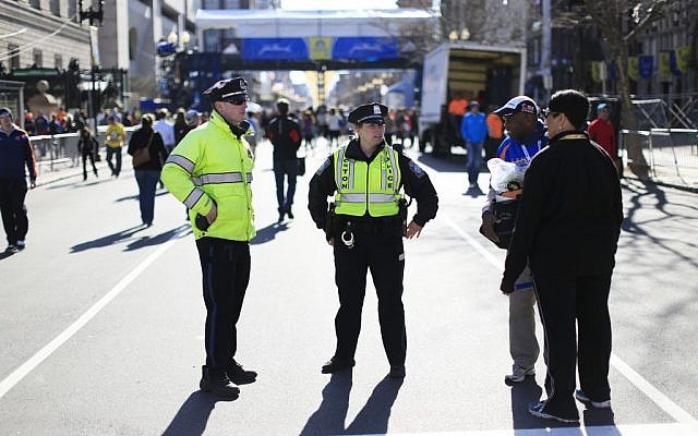 Police stand by near the finish line ahead of Monday's 118th Boston Marathon, Sunday, April 20, 2014, in Boston. Massachusetts Gov. Deval Patrick says officials are striking a balance between more security and maintaining the city's festive spirit. (photo credit: AP/Matt Rourke)