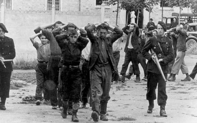 French resistance fighters held by Vichy regime militias during World War II. (CC-BY-SA  German Federal Archive Wikimedia Commons)