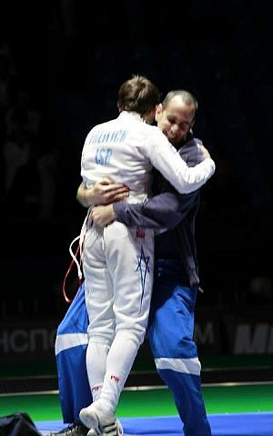 Yuval Freilich's coach, Ohad Balva of the Kfar Saba Fencing Club, hugs the teenager after his victory  at the 2012 Cadet World Championships in Moscow (Photo courtesy of Rachel Freilich)
