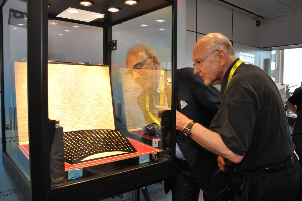 Italian jewelry designer Roberto Coin (left) next to a diamond display. (photo credit: courtesy IDE).