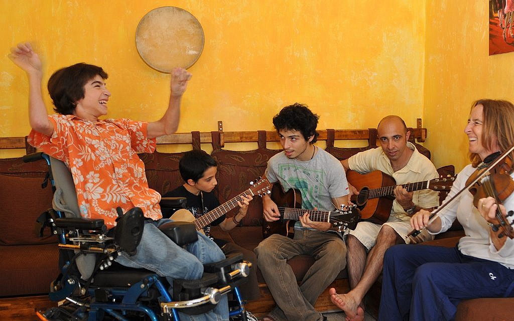 Rotem Elnatan cheers as his brothers, Inbar and Shachar, his father, Zohar, and his mother, Debby, perform. The entire family loves music. (Photo courtesy of Debby Elnatan)