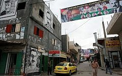 Graffiti and banners are seen in Deheishe refugee camp, near Bethlehem (Maya Levin/Flash90/File)