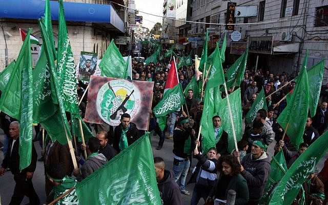Hamas supporters rally in the West Bank city of Ramallah in 2012. (photo credit: Issam Rimawi/Flash90)