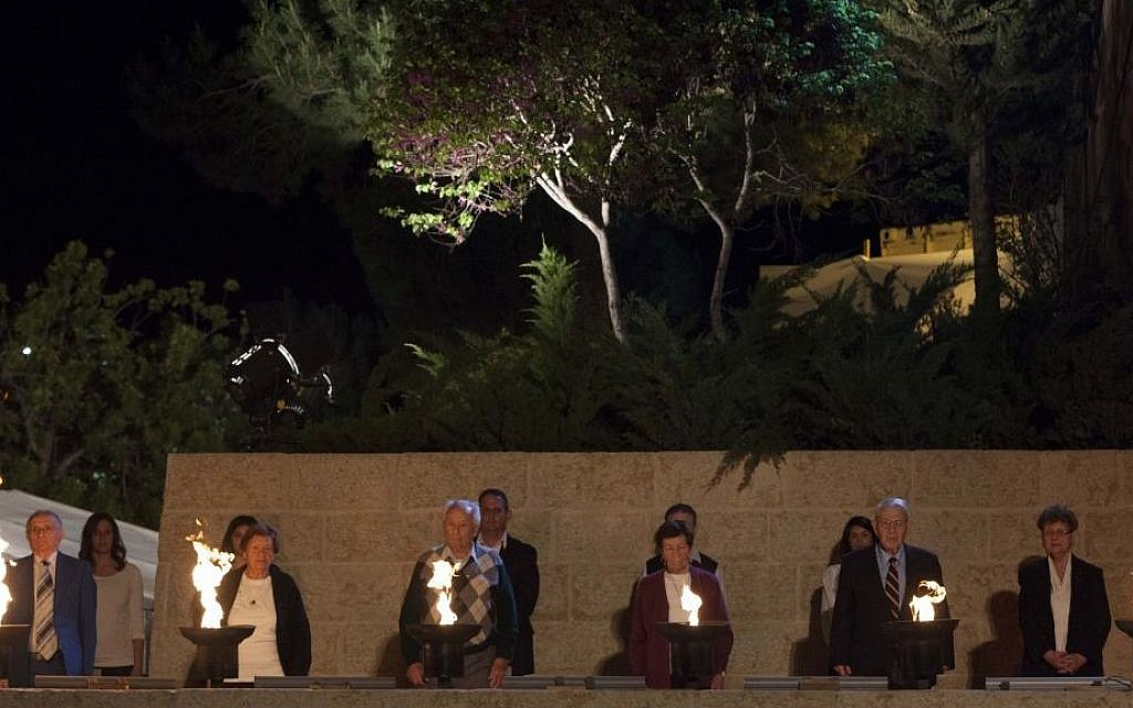 Six Holocaust survivors are chosen each year to light the torches representing the six million victims of the Nazi genocide during the opening ceremony of Holocaust Remembrance Day at the Yad Vashem Holocaust Memorial Museum in Jerusalem. (photo credit: Yonatan Sindel/Flash 90)