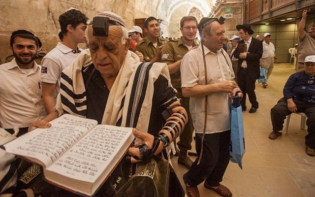 Illustrative photo of Holocaust survivors celebrating their belated Bar Mitzvahs in one of the tunnel sections at the Western Wall in Jerusalem, in 2013. (photo credit: Flash90)