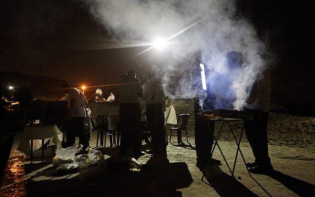 Illustration. Ultra-Orthodox Jewish men seen doing barbecue. (photo credit: Yaakov Naumi/Flash90)